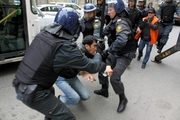 Thumb_police-beaten-oppositioner-activists-who-was-in-protest-action-baku-2-april-2011