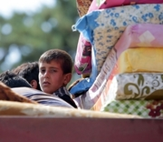 Thumb_453330580-syrian-refugees-sit-in-the-back-of-a-pick-up-truck-as.jpg.crop.thumbnail-small